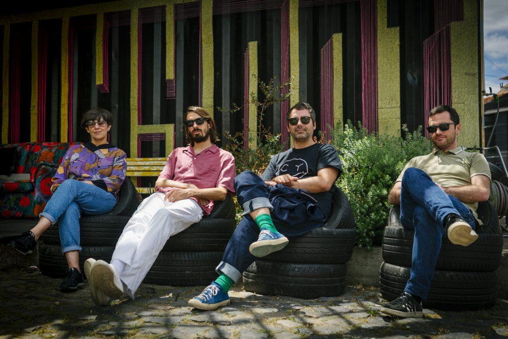 Sofia Mestre, Nicolai Sarbib, Nuno Patrício e Marco Guerra sitted on tires at Village Underground Lisboa